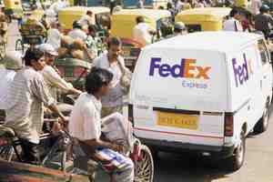 Fxe_truck_navigates_crowded_streets_of_delhi_india