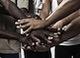 Hands-joining-shutterstock_123739879-300x220